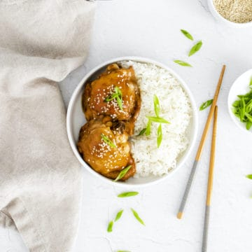 the completed instant pot honey garlic chicken served in a bowl with rice