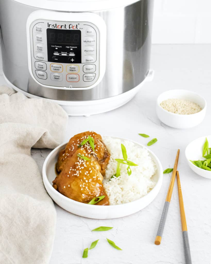 the completed honey garlic chicken recipe served in a bowl and placed in front of the instant pot