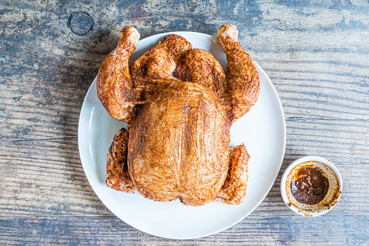 a whole chicken rubbed with Indian spices and ready to be cooked in the Instant Pot