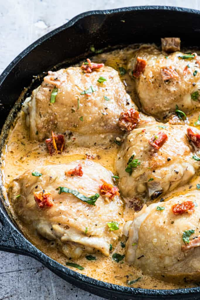 the cooked marry me chicken recipe in a cast iron skillet
