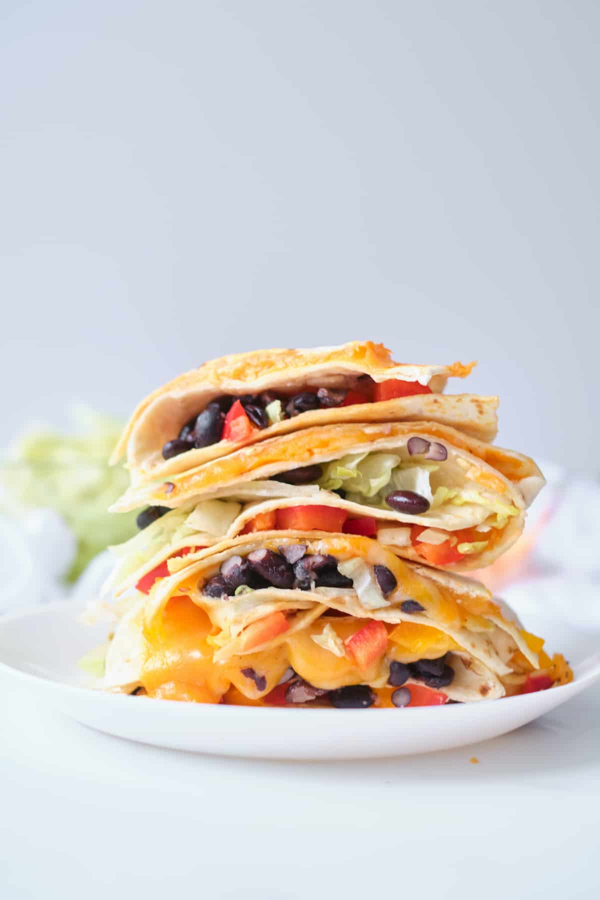 black bean quesadillas stacked on top of one another
