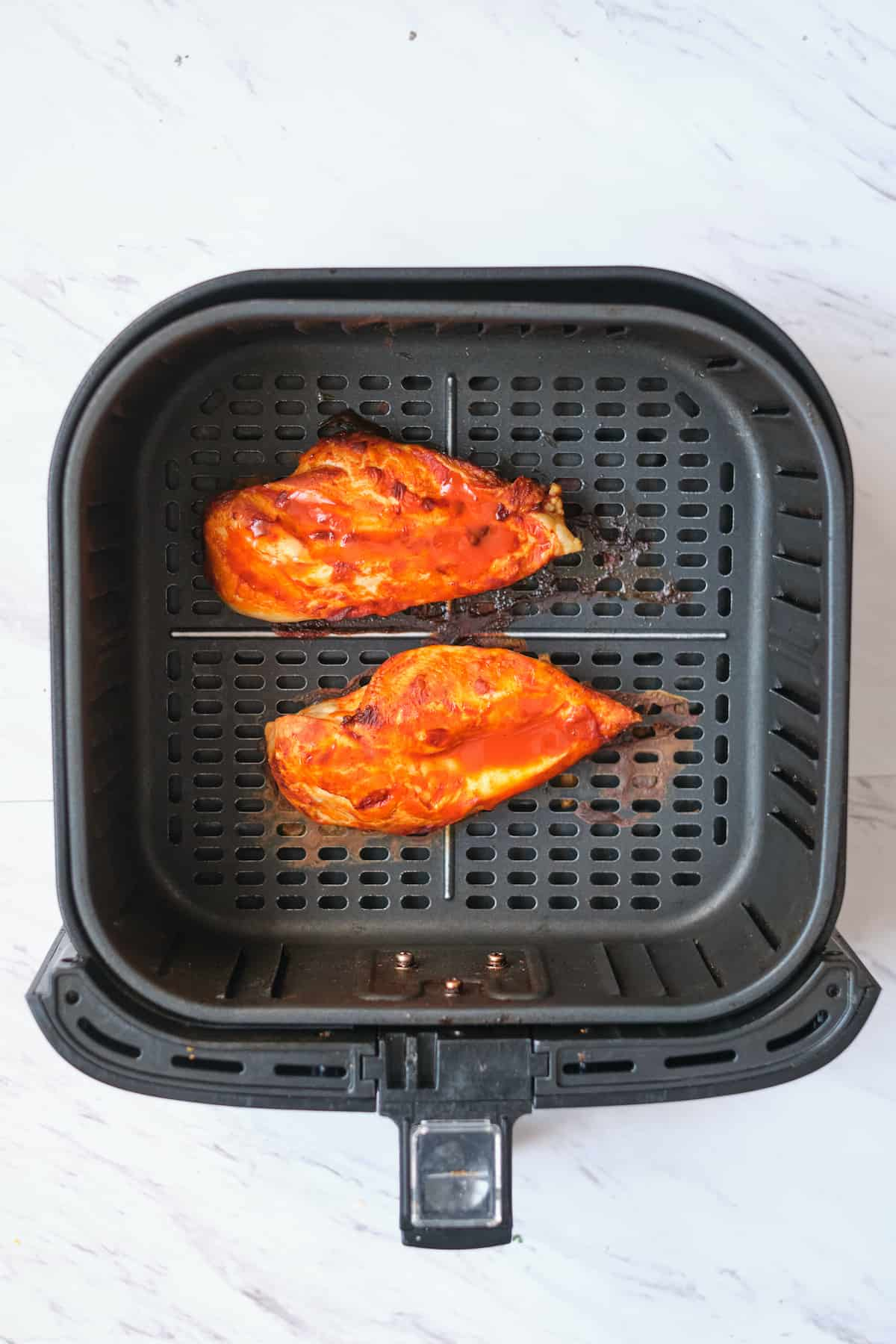 top down view of the cooked buffalo chicken in air fryer