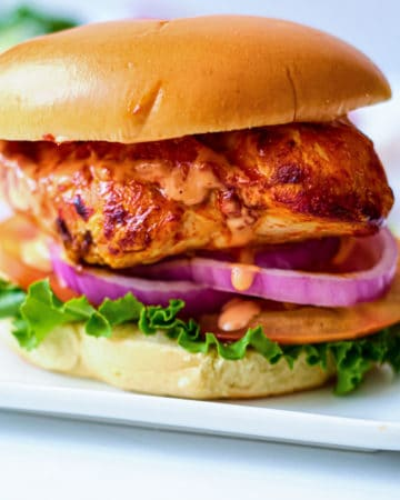 close up view of a completed buffalo chicken sandwich