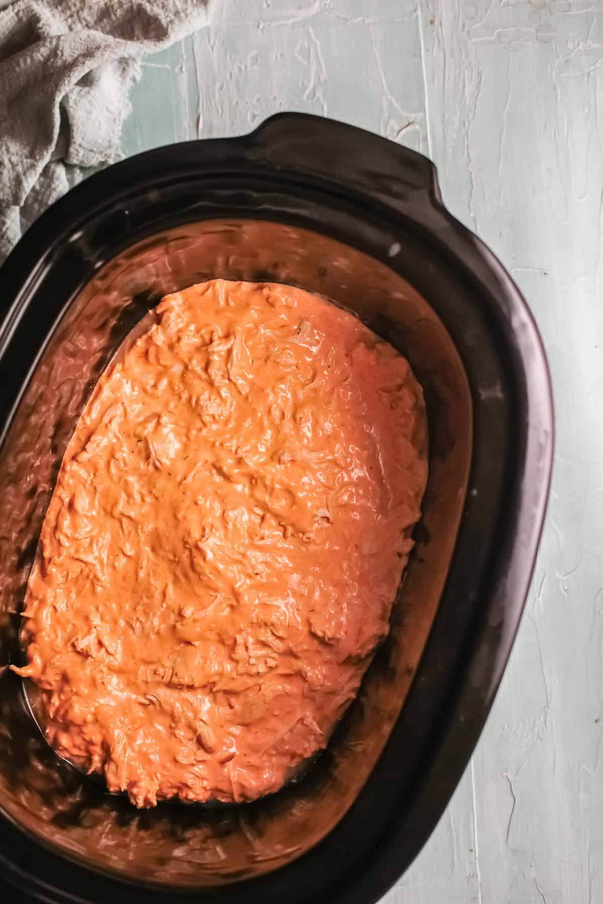 top down view of the finished slow cooker buffalo chicken dip inside the crockpot