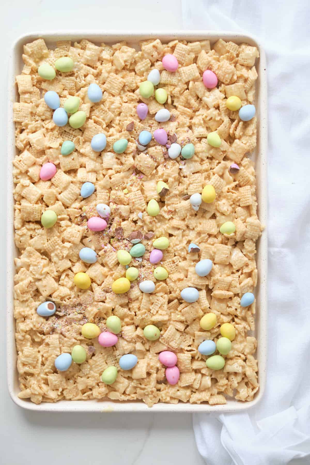top down view of a baking sheet filled with the finished no bake chex bars and ready to cut into squares