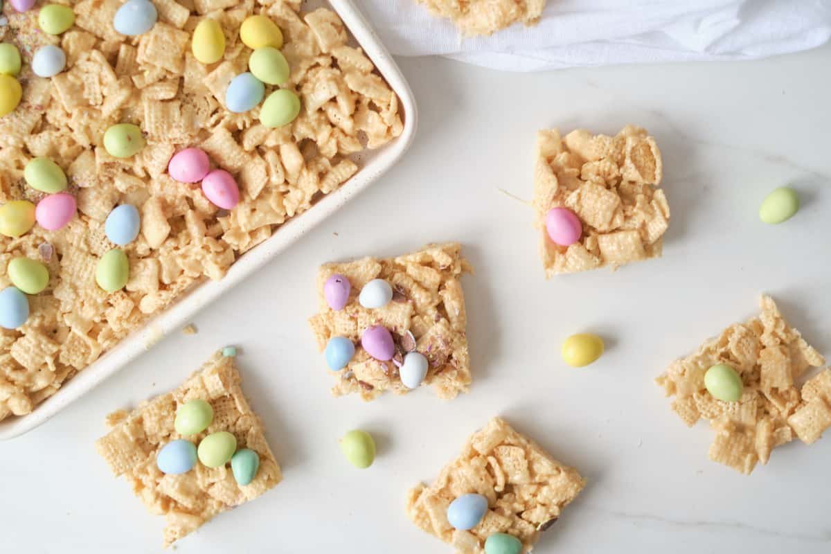 four of the finished Easter no bake chex bars on a countertop next to the baking tray