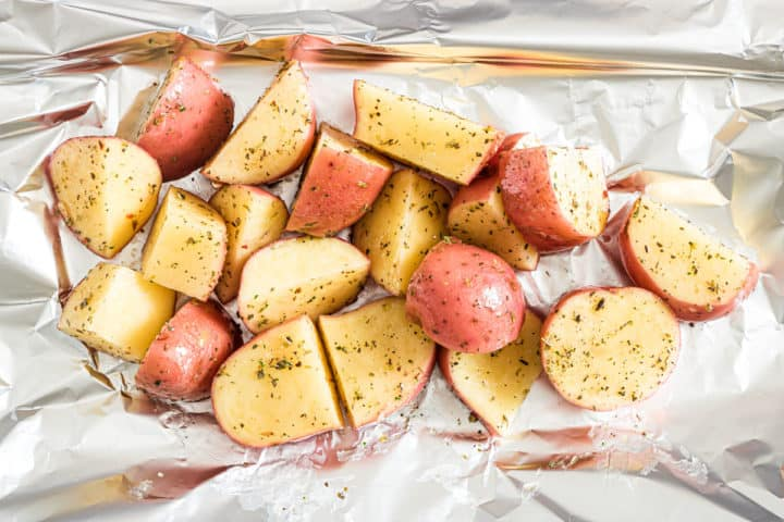 cut red potatoes ready to be cooked in a foil packet