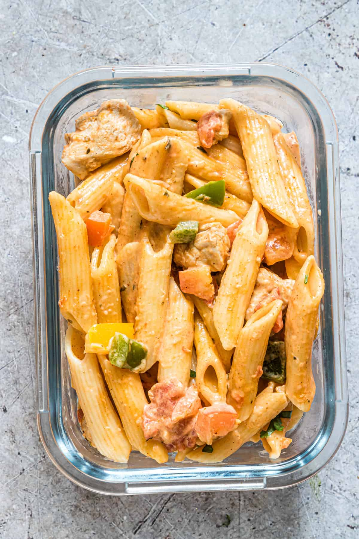 a meal prep bowl filled with chicken fajita pasta