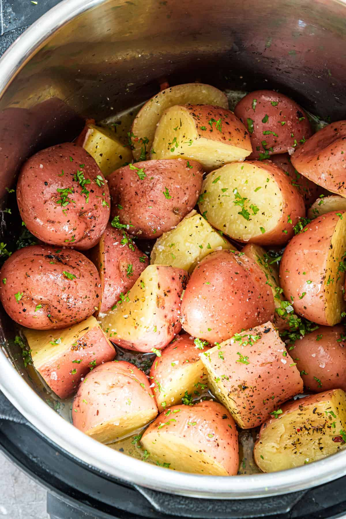 close up view of the garlic butter red potatoes inside the instant pot