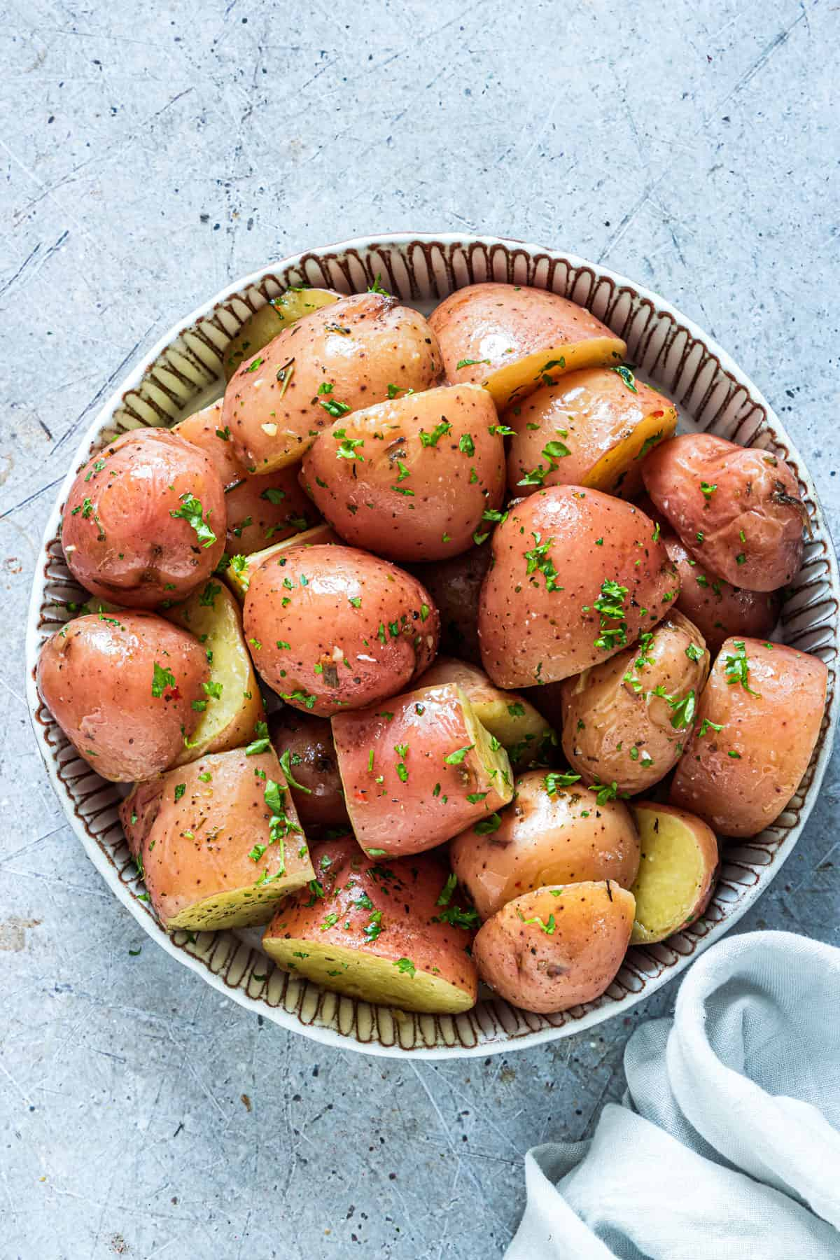 top down view of a ceramic bowl filled with Instant Pot Red Potatoes