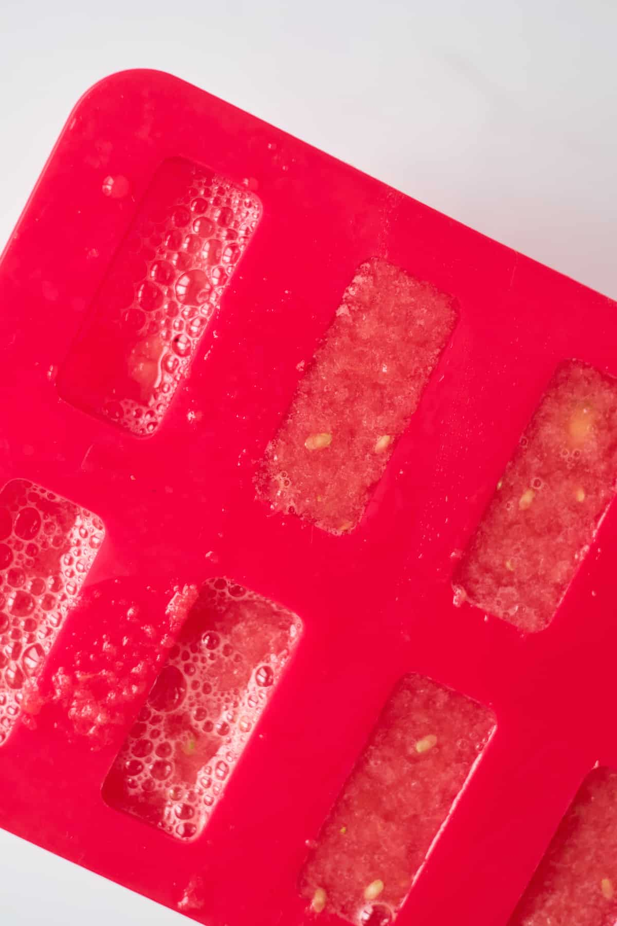 close up view of the mexican popsicles inside the mold
