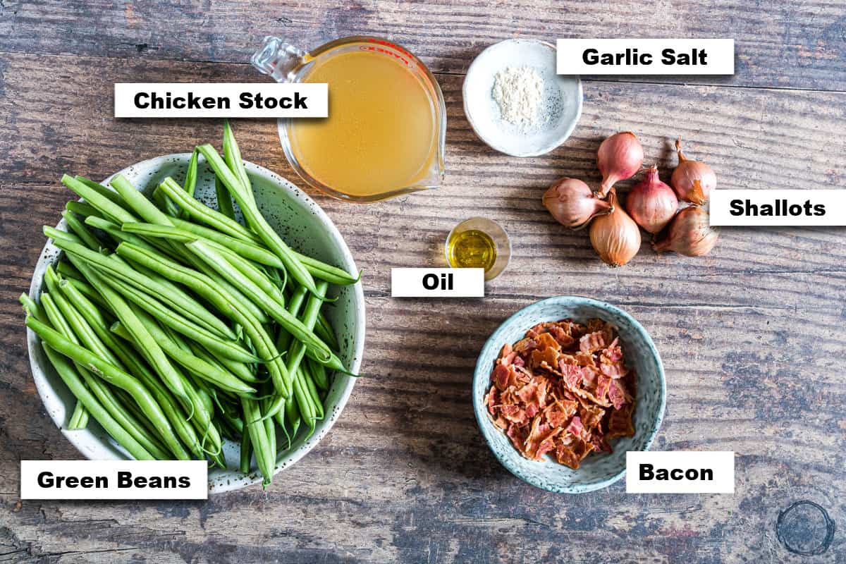 the ingredients needed for making smothered green beans with bacon