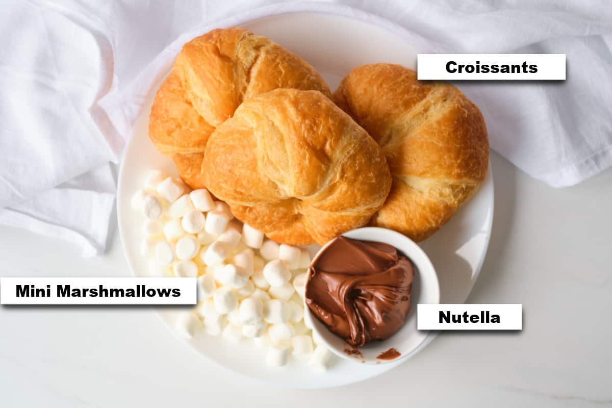 the ingredients needed for making stuffed croissant breakfast boats