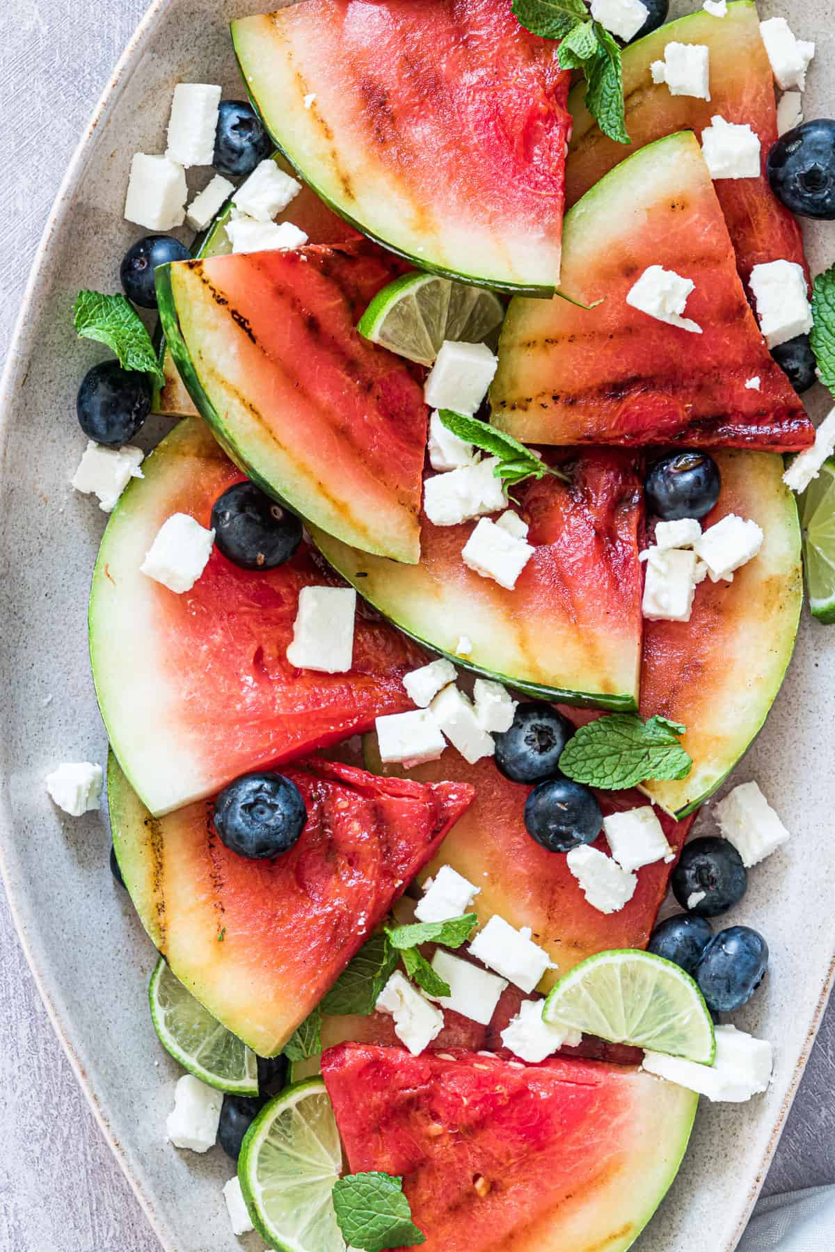 close up view of the grilled watermelon feta salad on a serving platter