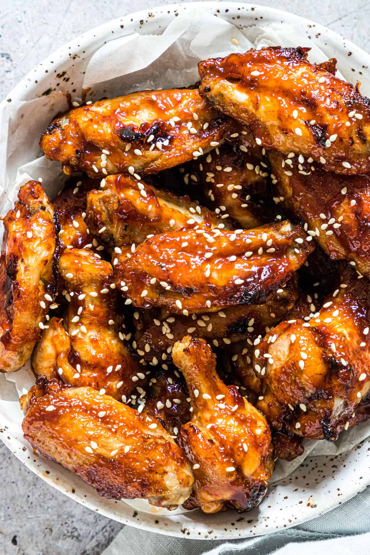 close up of a plate sticky coca cola chicken wings made in the air fryer