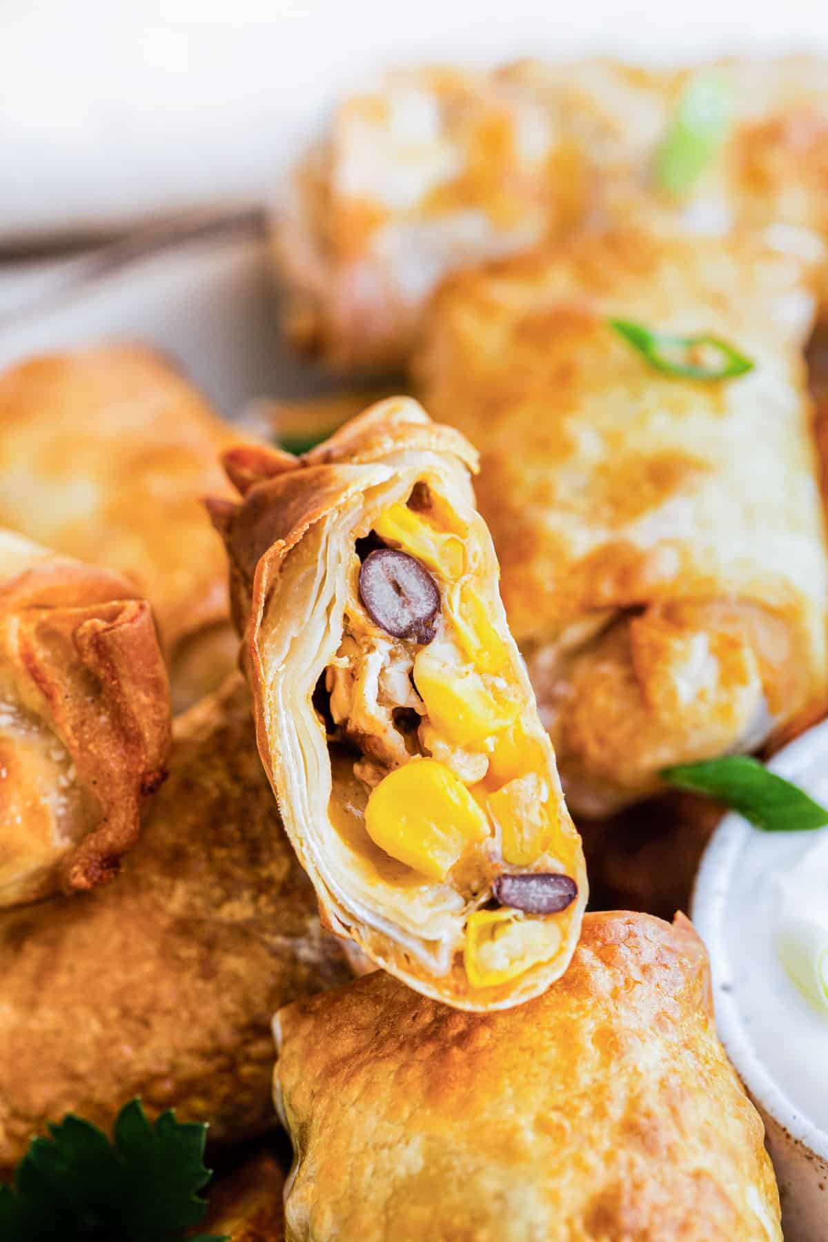 close up of a southwest Egg roll with corn and beans showing