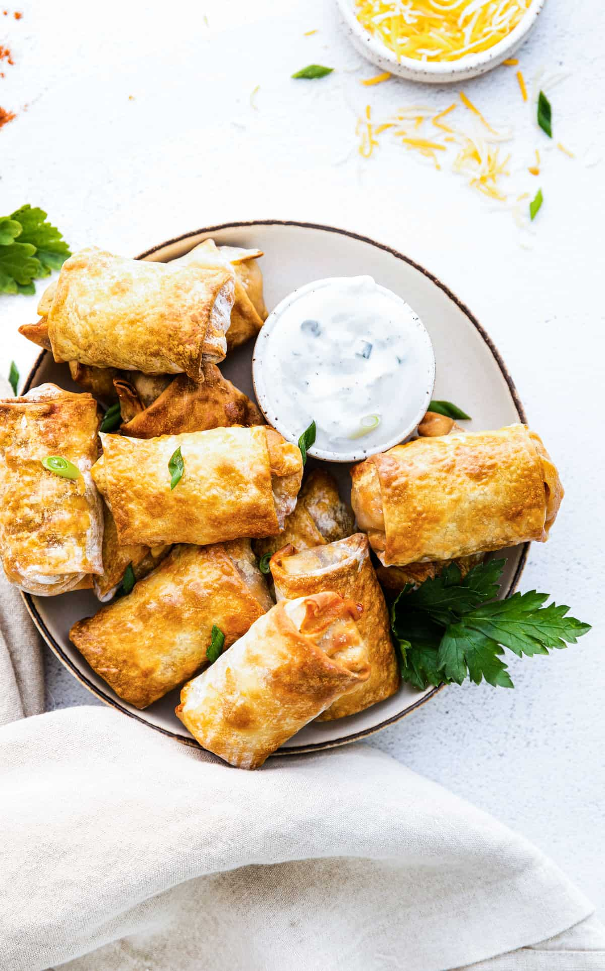 A Plate of Air Fryer Southwest Egg Rolls with a dipping sauce