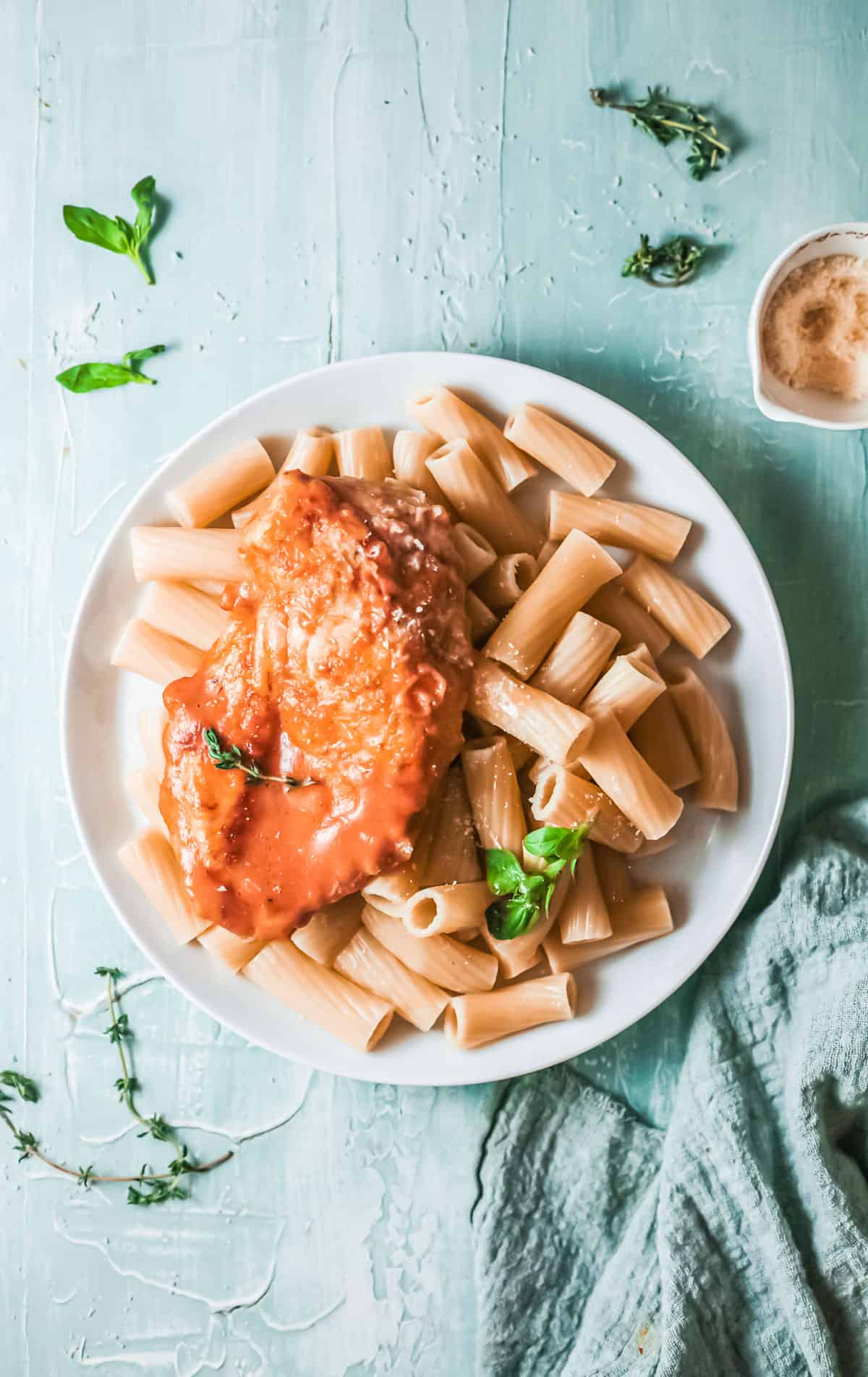 top down view of one serving of cajun chicken and pasta on a white plate