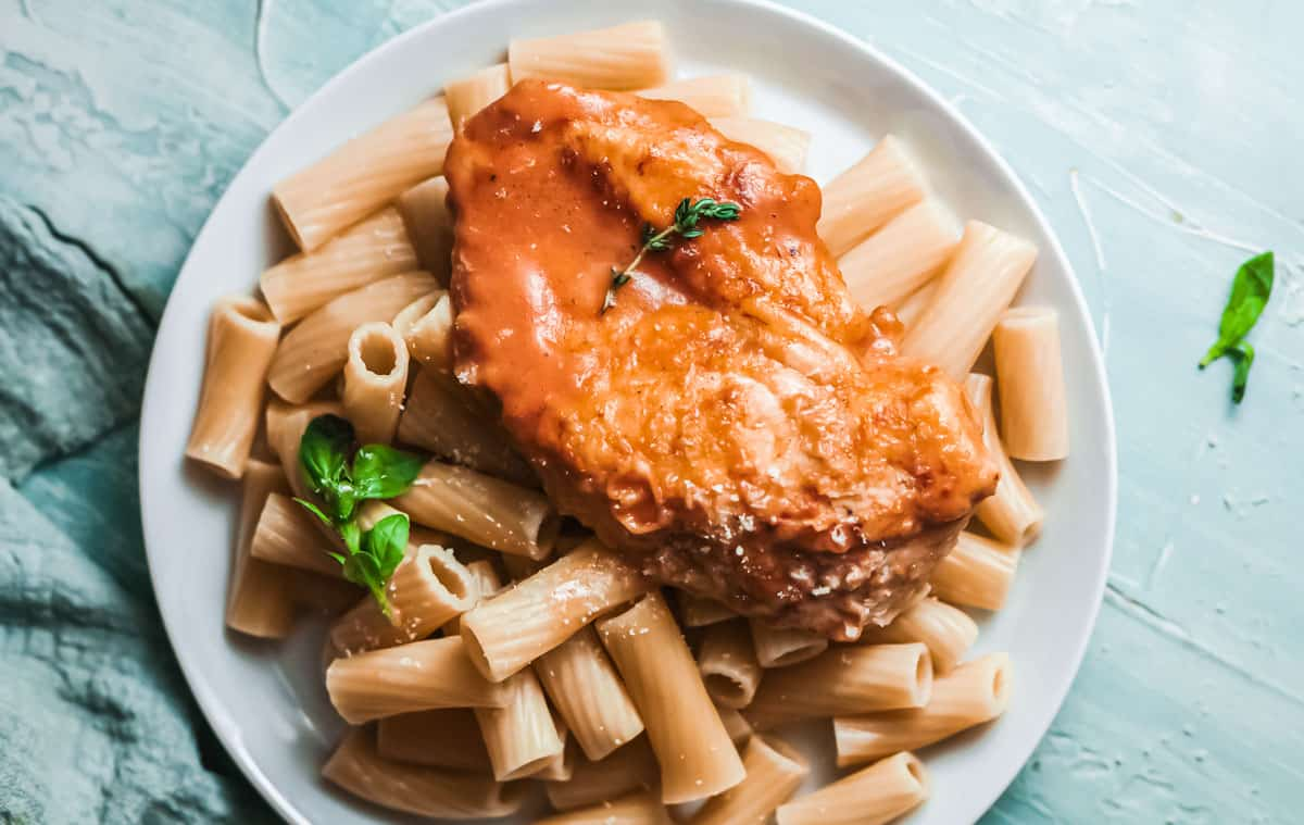 a plate of pasta and creamy cajun chicken
