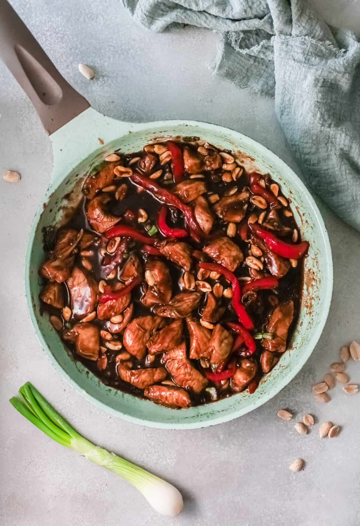 the finished kung pao chicken recipe inside a skillet and ready to serve
