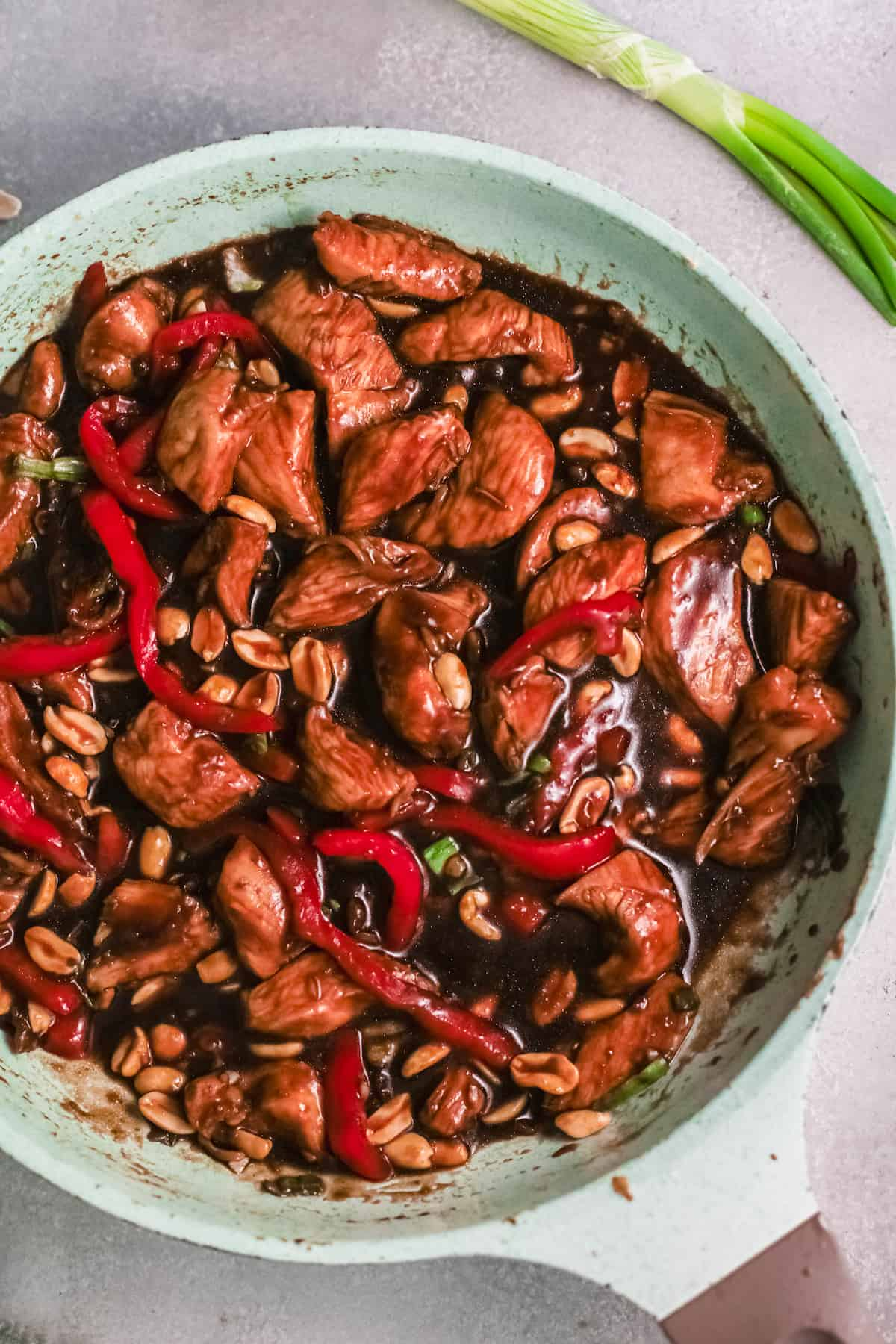 top down view of the kung pao chicken inside a large skillet