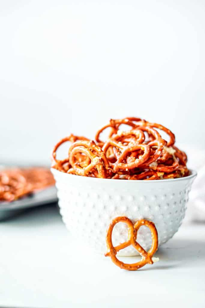 a bowl of ranch pretzels on a table