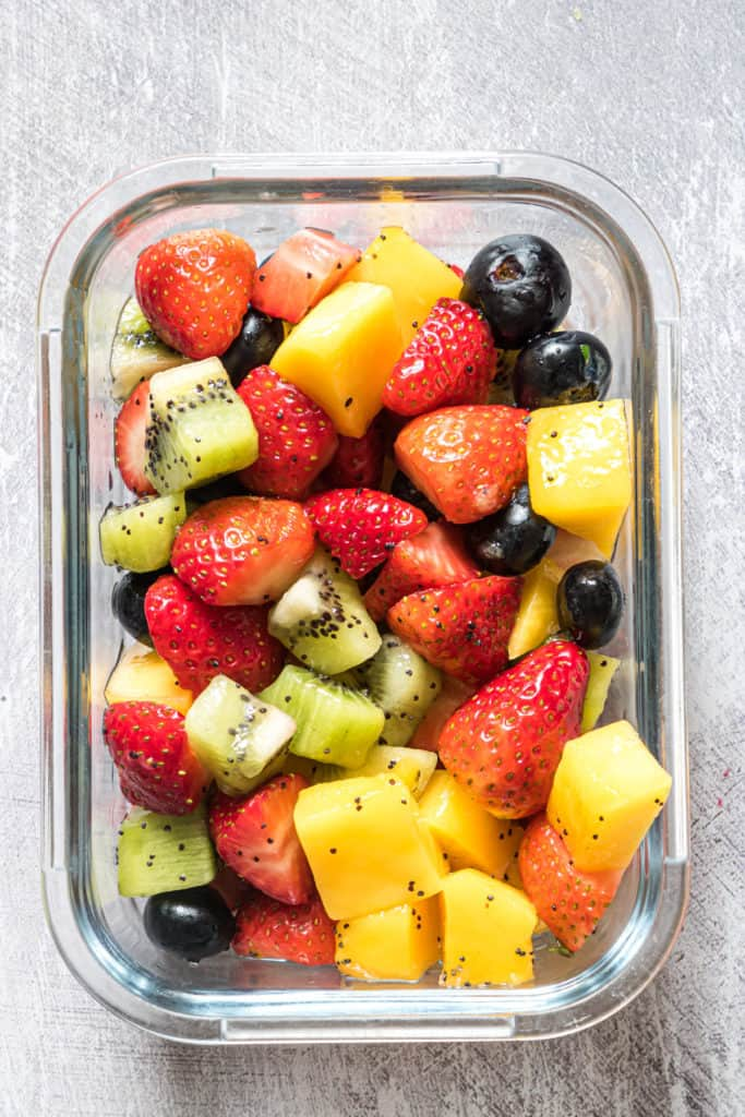 a portion of fruit salad inside a glass food storage container