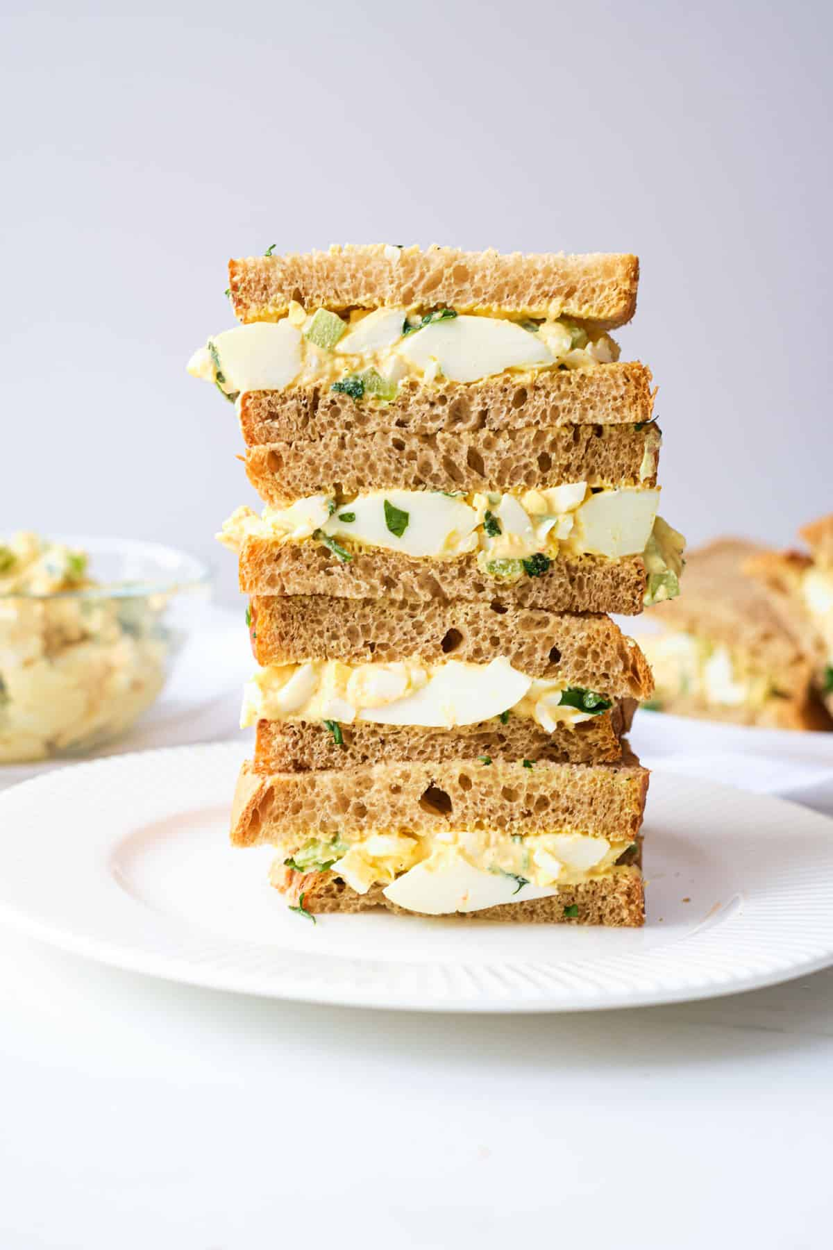 the finished egg salad sandwich halves stacked vertically