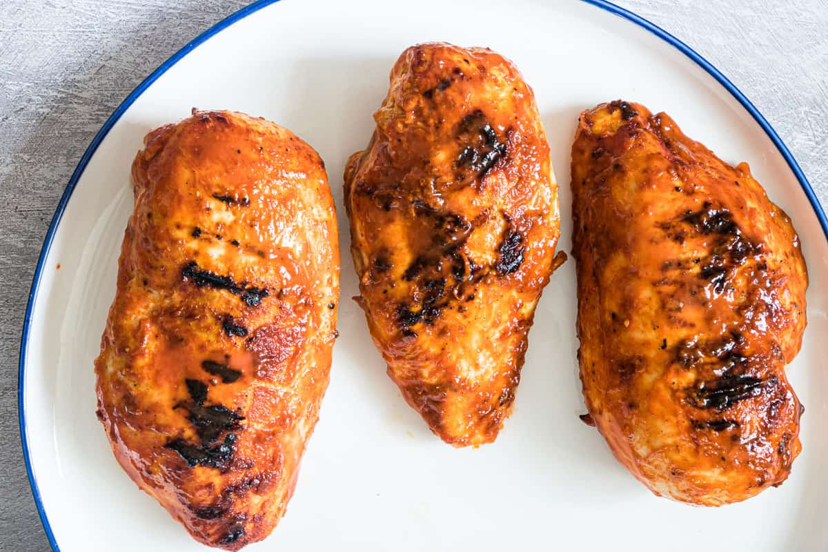 3 grilled buffalo chicken breasts on a plate
