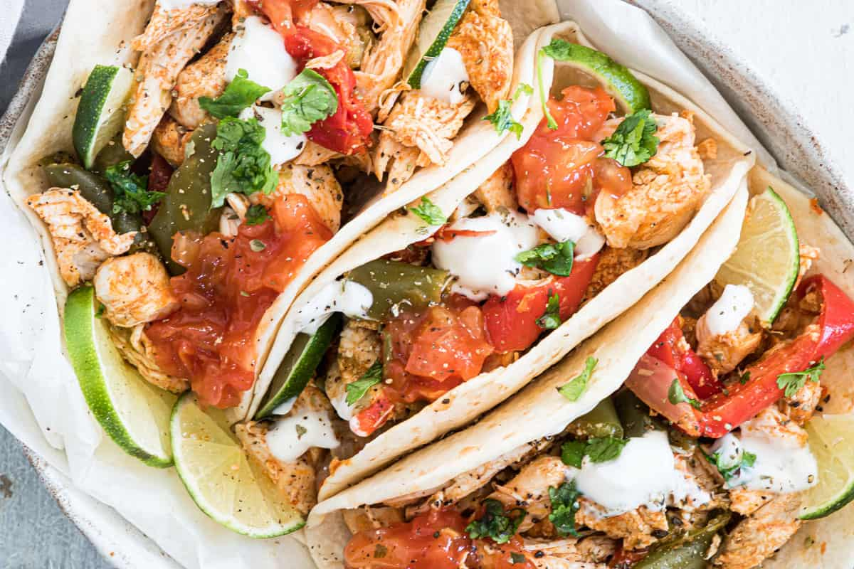 close up view of three completed instant port chicken fajitas