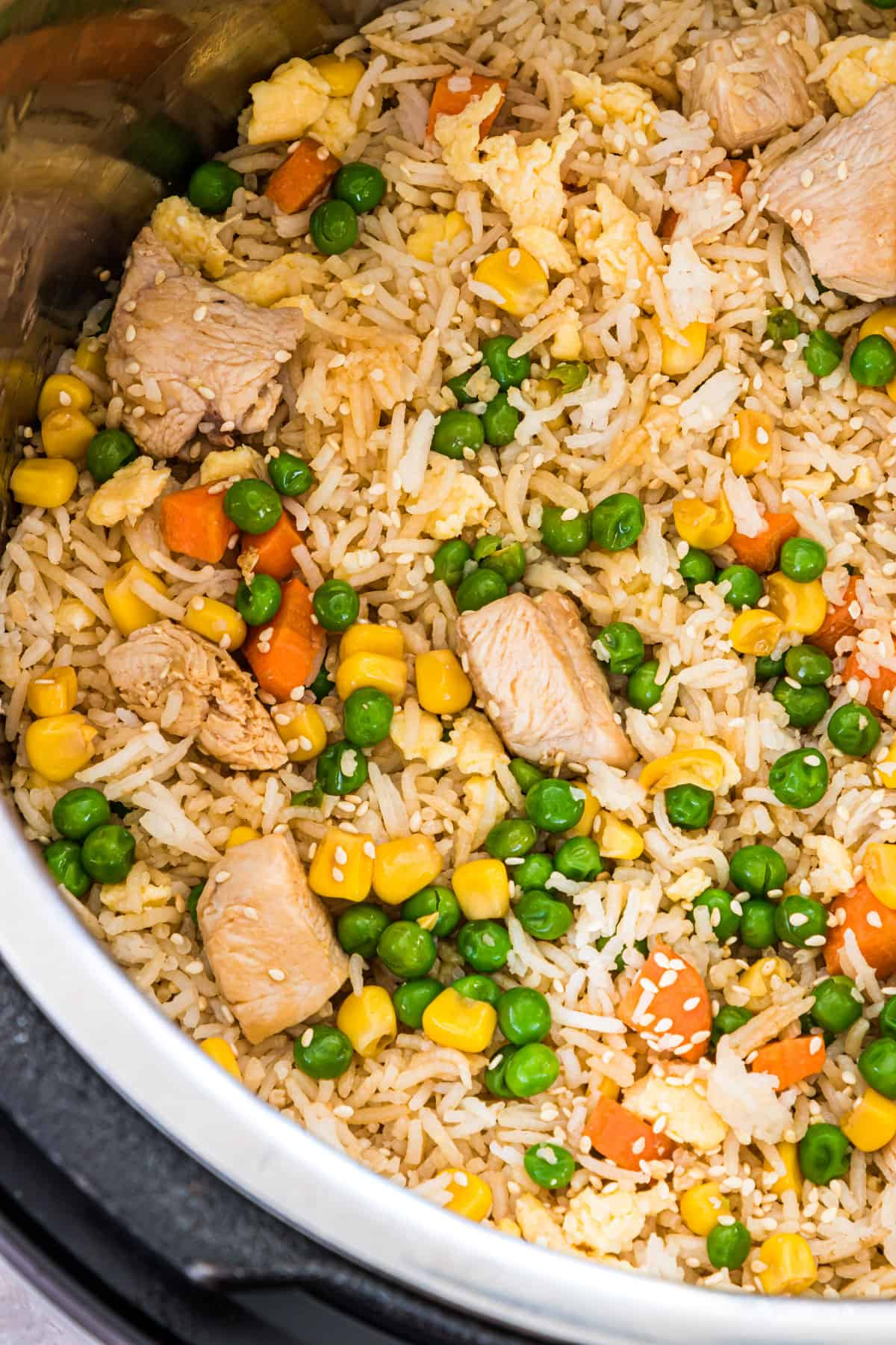 close up view of the instant pot chicken fried rice inside the instant pot