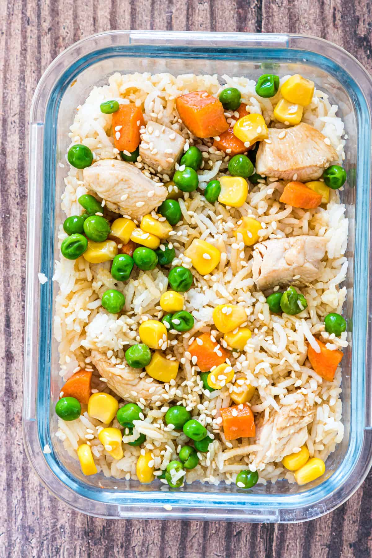 a portion of instant pot chicken fried rice in a glass meal storage container