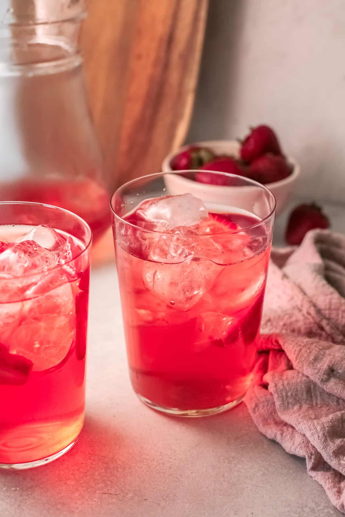 two glasses filled with the completed strawberry sweet tea