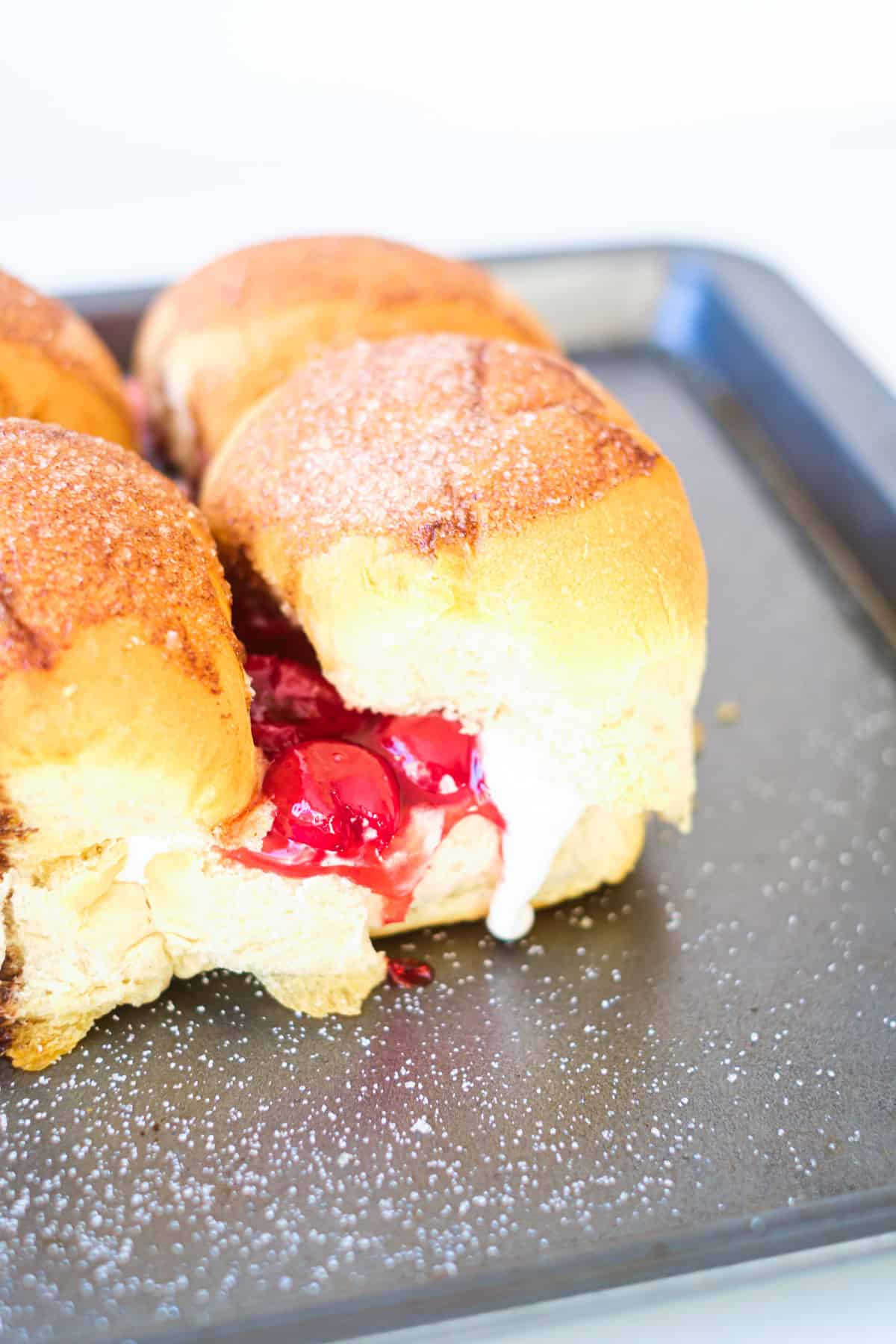 the finished cherry pie sliders on a baking pan