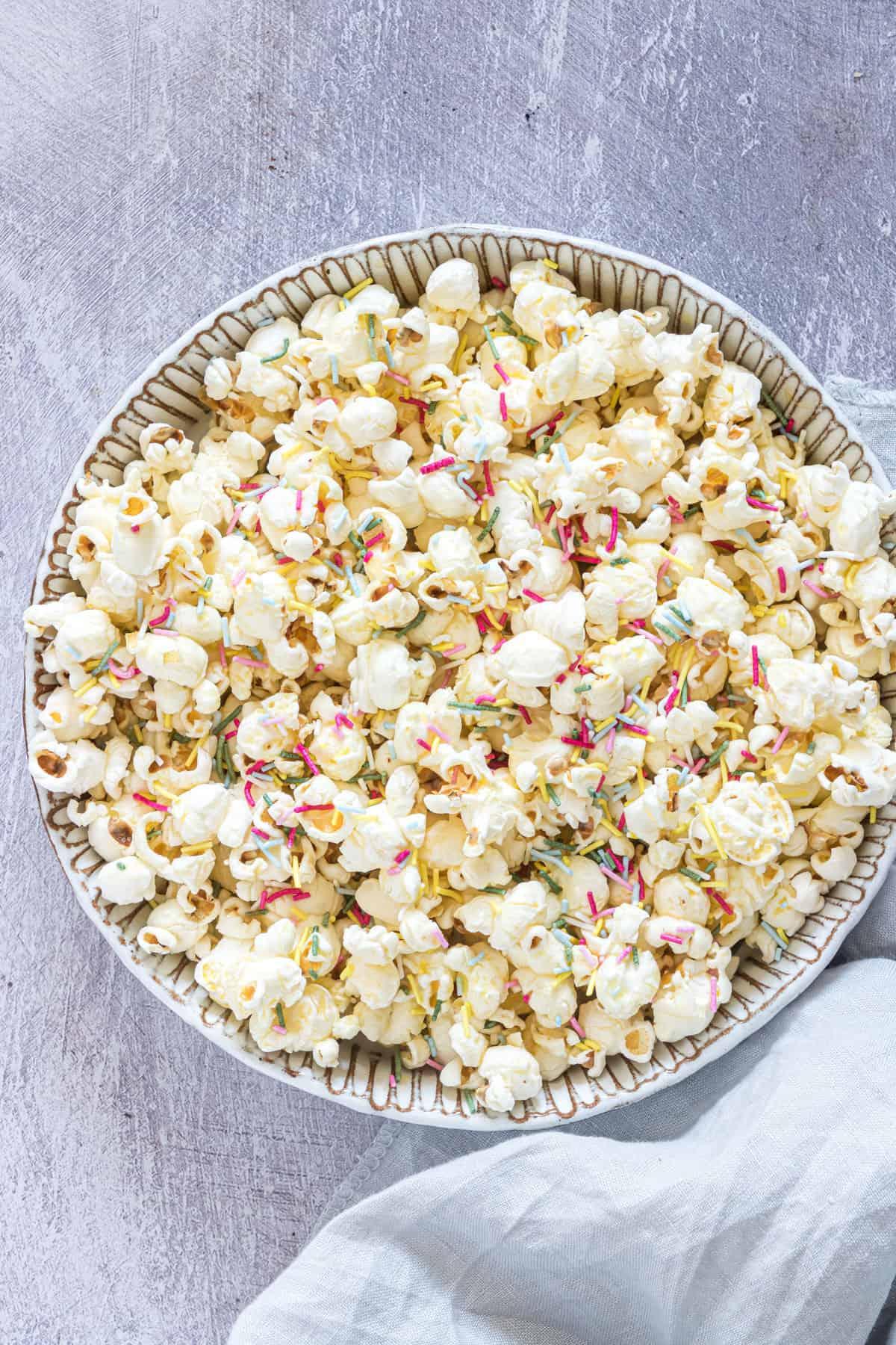 Funfetti popcorn in a bowl on a table