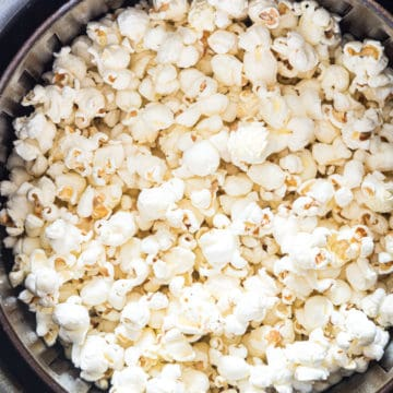 cooked air fryer popcorn in an air fryer basket