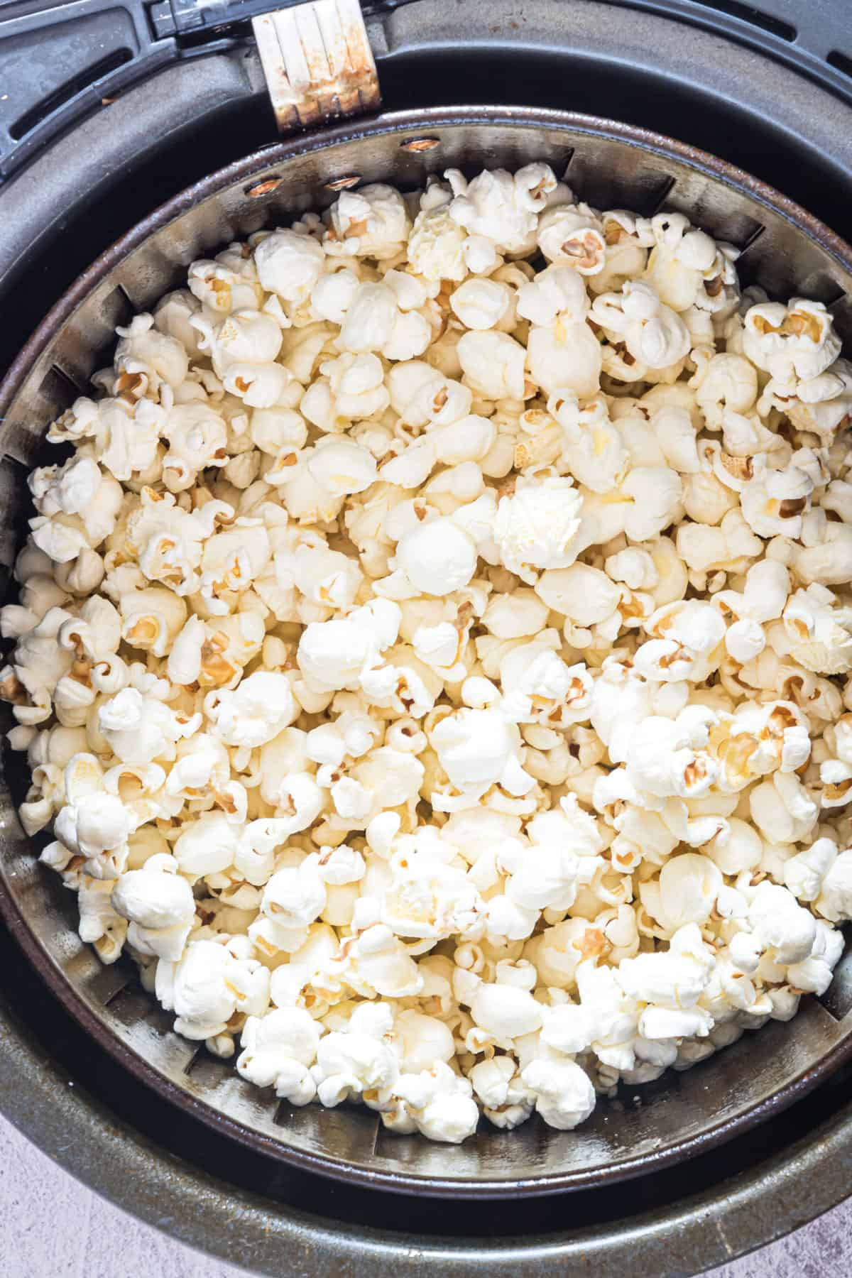 Air Fried Popcorn in and Air Fryer basket