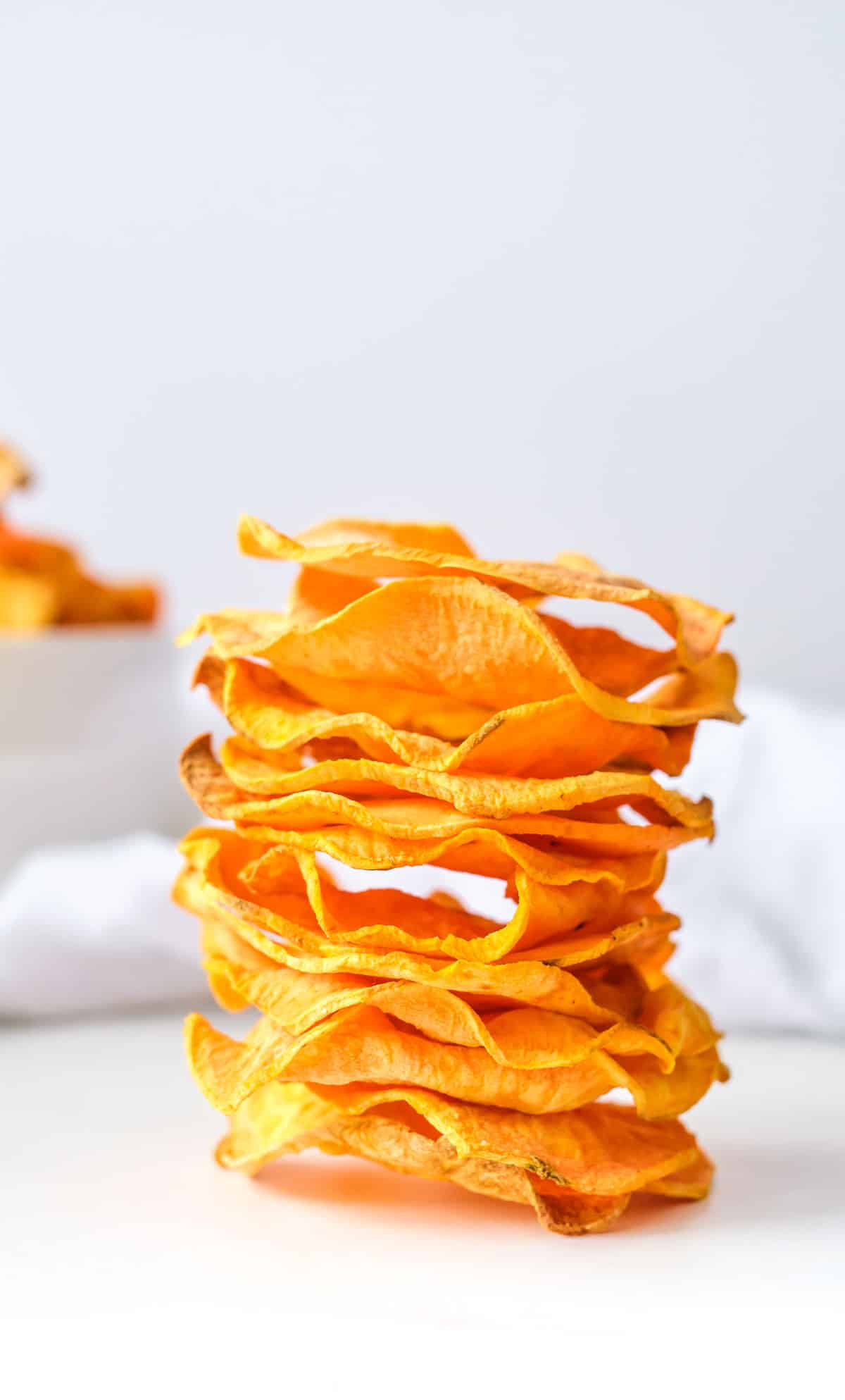 a stack of air fryer sweet potato chips on a table