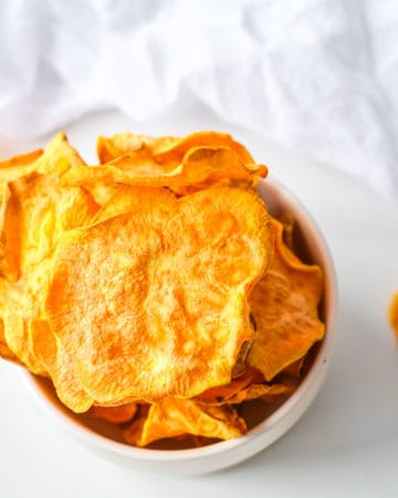 top down view of a stack of completed air fryer sweet potato chips