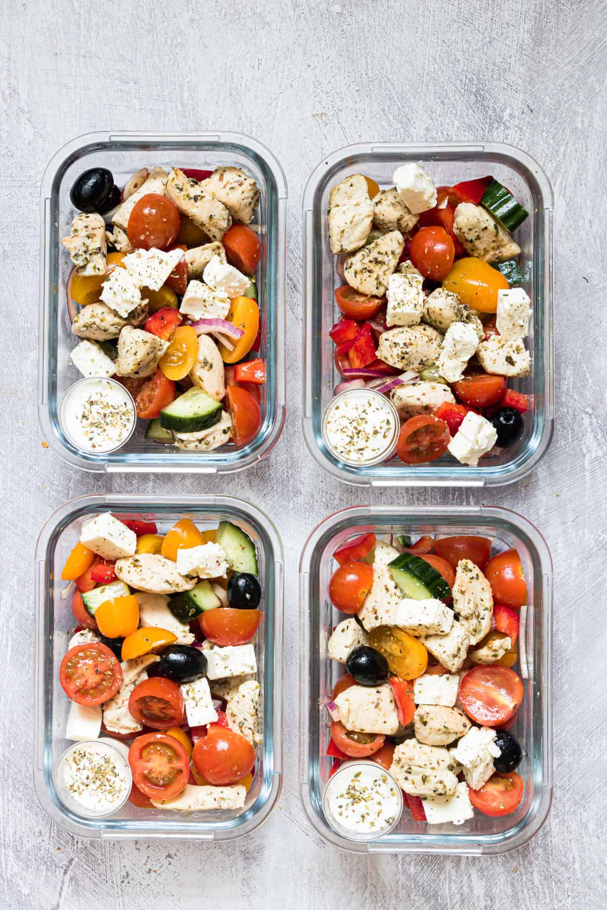 top down view of the finished greek chicken meal prep bowls