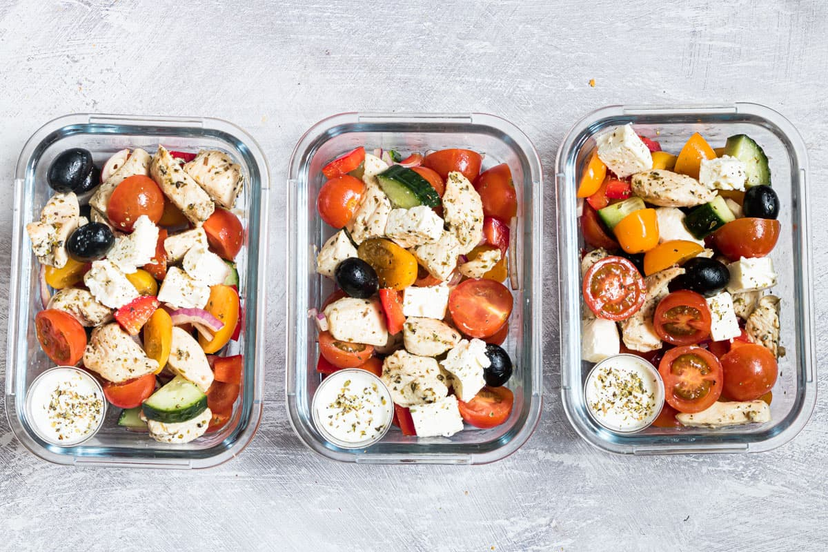 three meal prep containers filled with the greek chicken