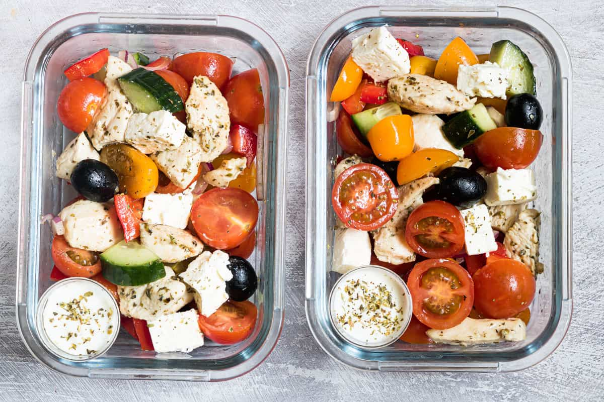 two meal prep containers filled with the competed greek chicken recipe