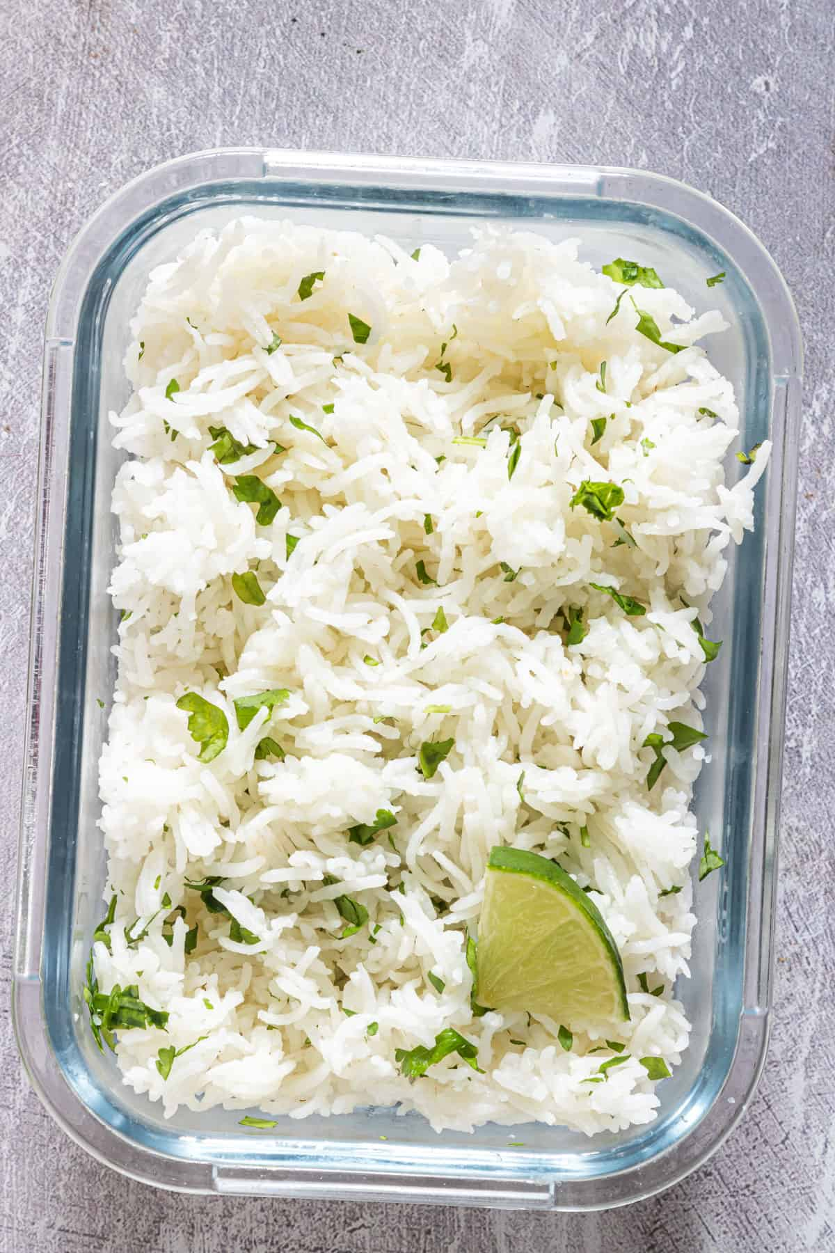 the finished cilantro lime rice inside a glass food storage container