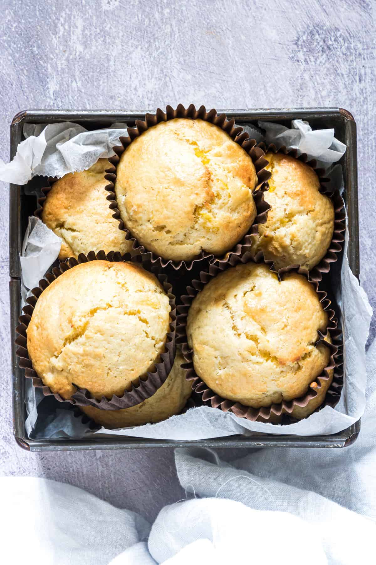 some baked pineapple coconut muffins