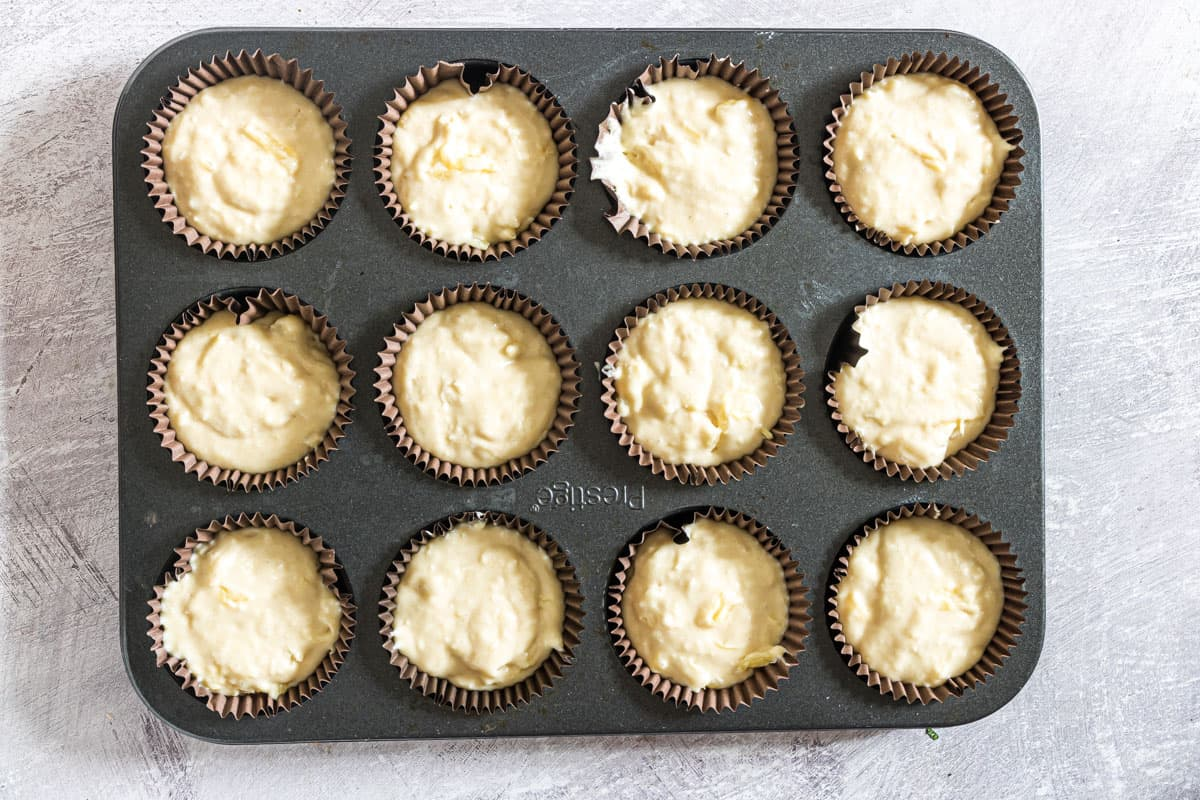 pineapple muffin batter in a muffin tray