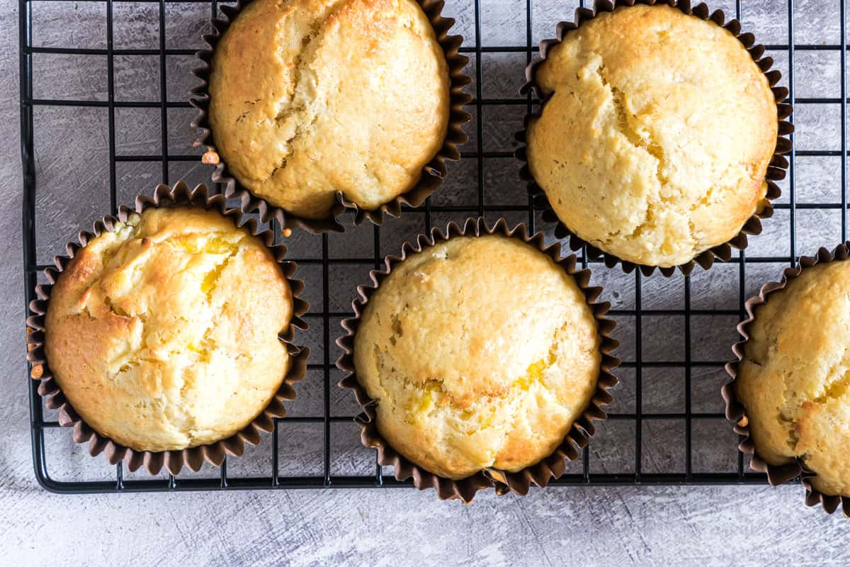 5 tropical muffins on a cooling rack