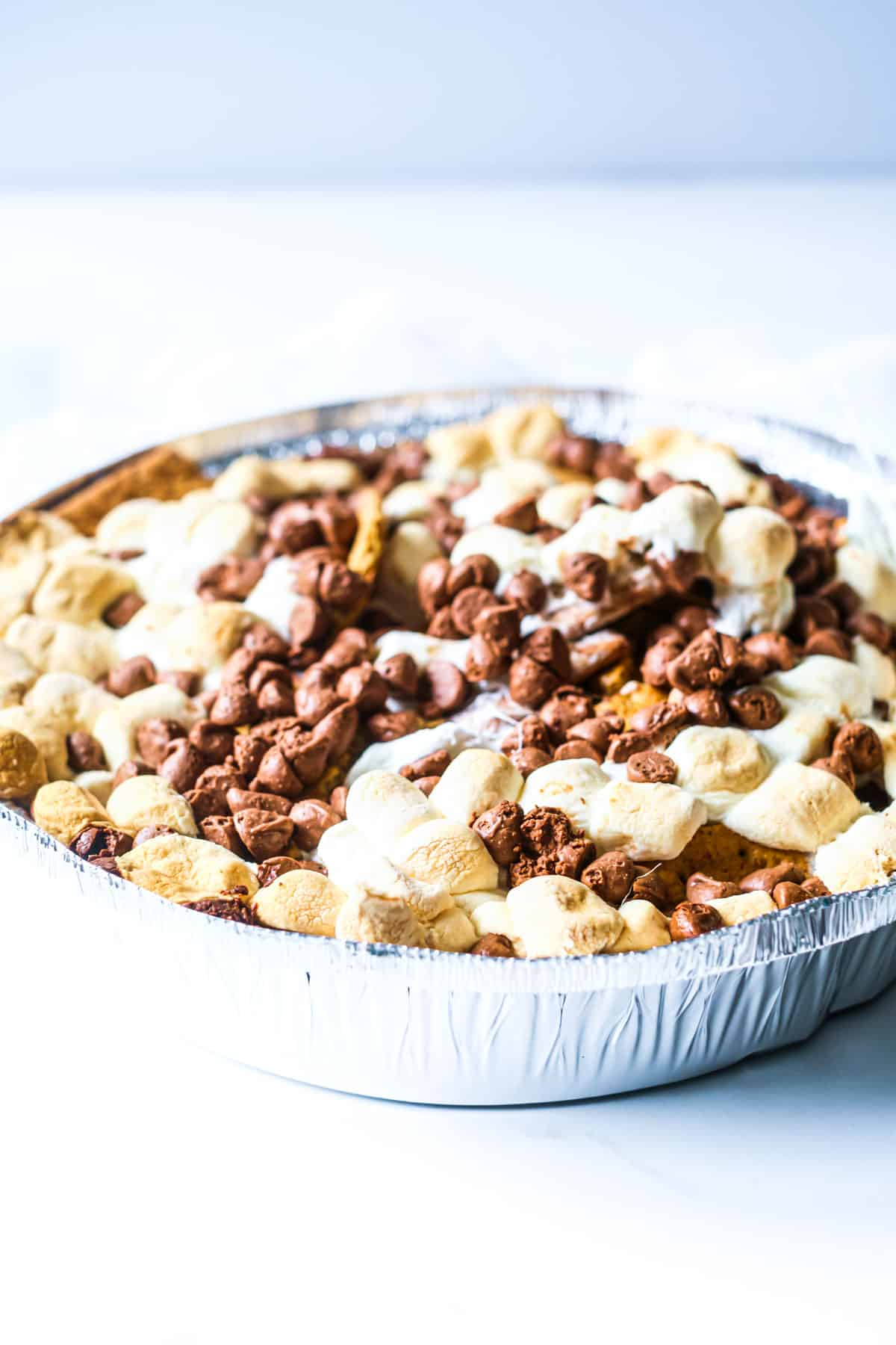 close up of a tray of grilled s'mores nachos