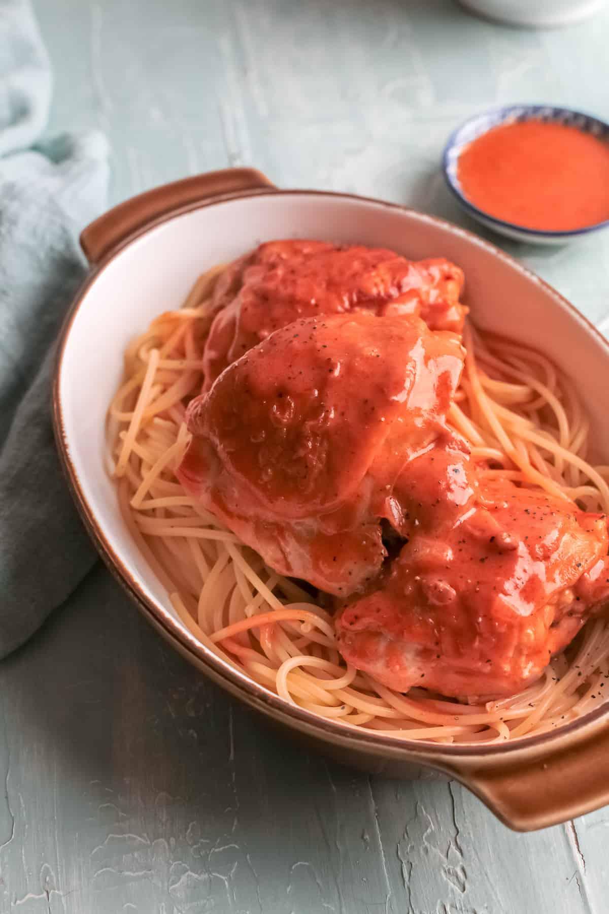 the finished instant pot chicken paprikash served over noodles