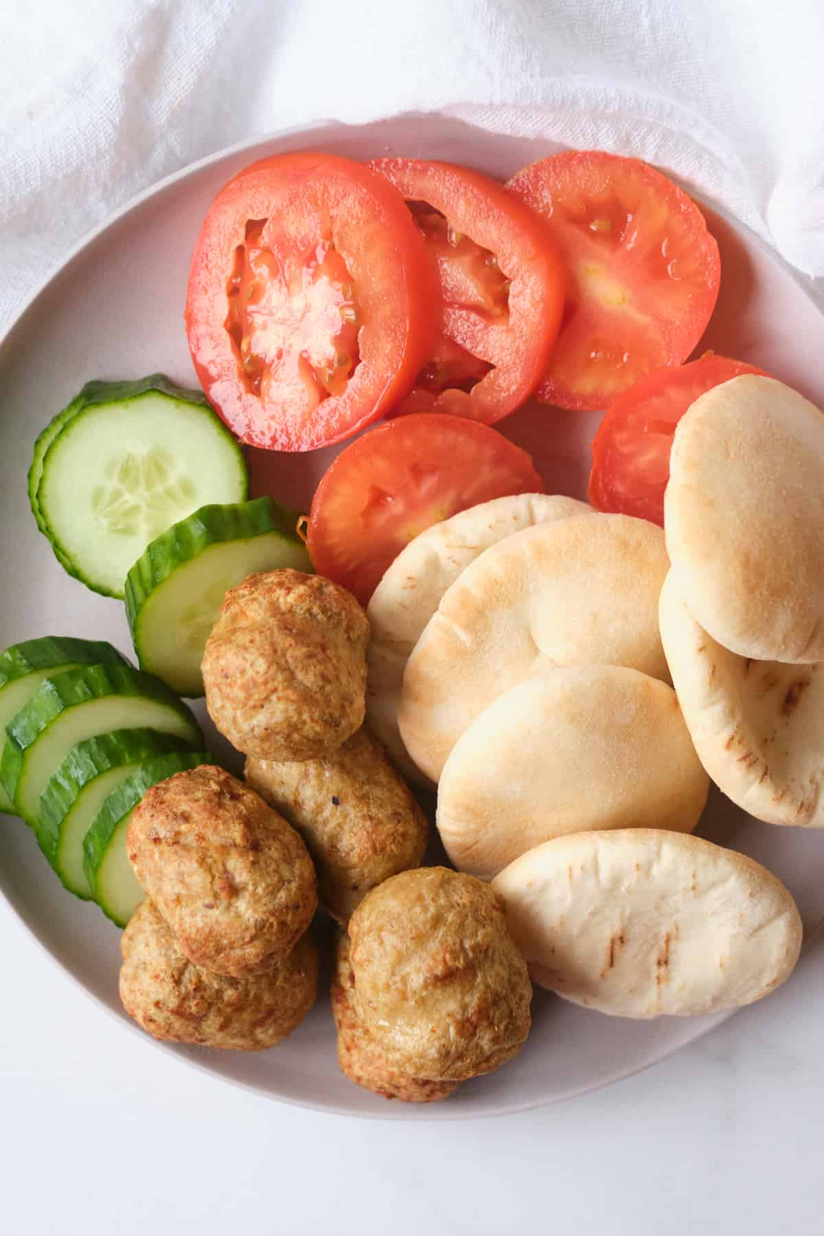 close up view of the ingredients needed for making meatball stuffed pita