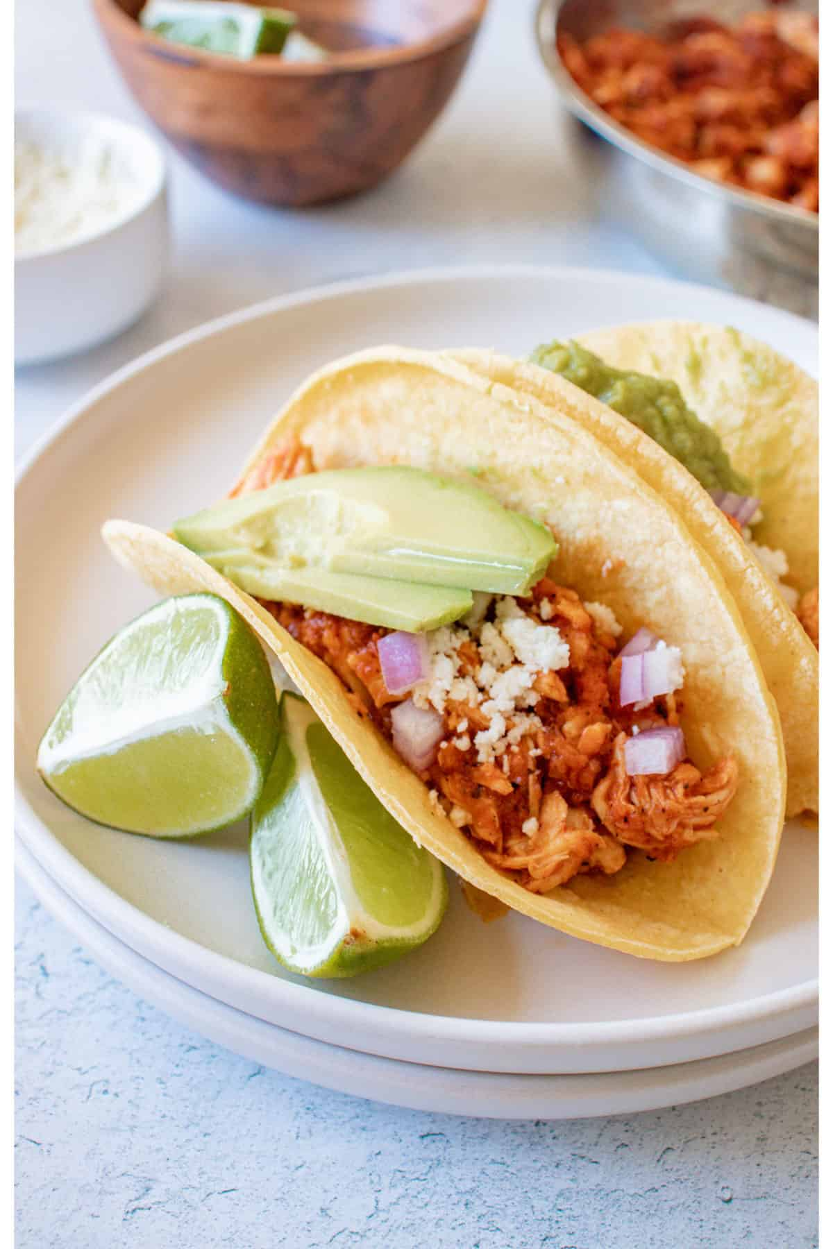 the completed chicken tinga tacos served on a white plate